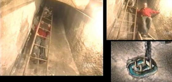 Zawi Hawass descending down a shaft towards a chamber filled with water that contained a large sarcophagus. Credit: Fox