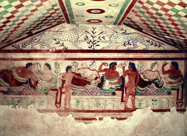 Un esempio di una tomba etrusca elaborato: Pittura di parete in una camera sepolcrale chiamato Tomba dei Leopardi presso la necropoli etrusca di Tarquinia a Lazio, Italia.