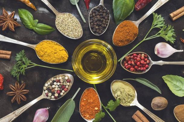 Culinary and medicinal spices and herbs on a wooden board