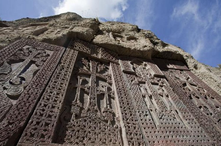 a row of khachkars at Geghard Monastery