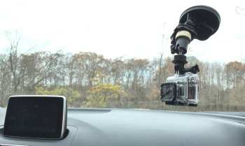 A ball head attached to a GoPro suction cup mount