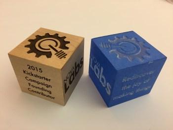 Backer cubes, wood and acrylic.