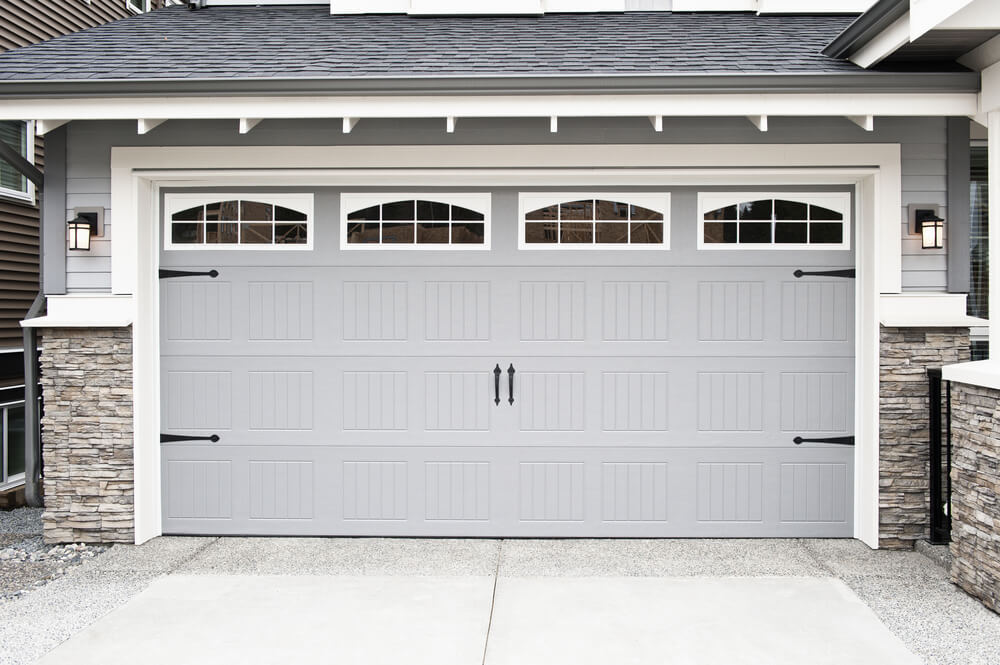 light gray garage door on a house