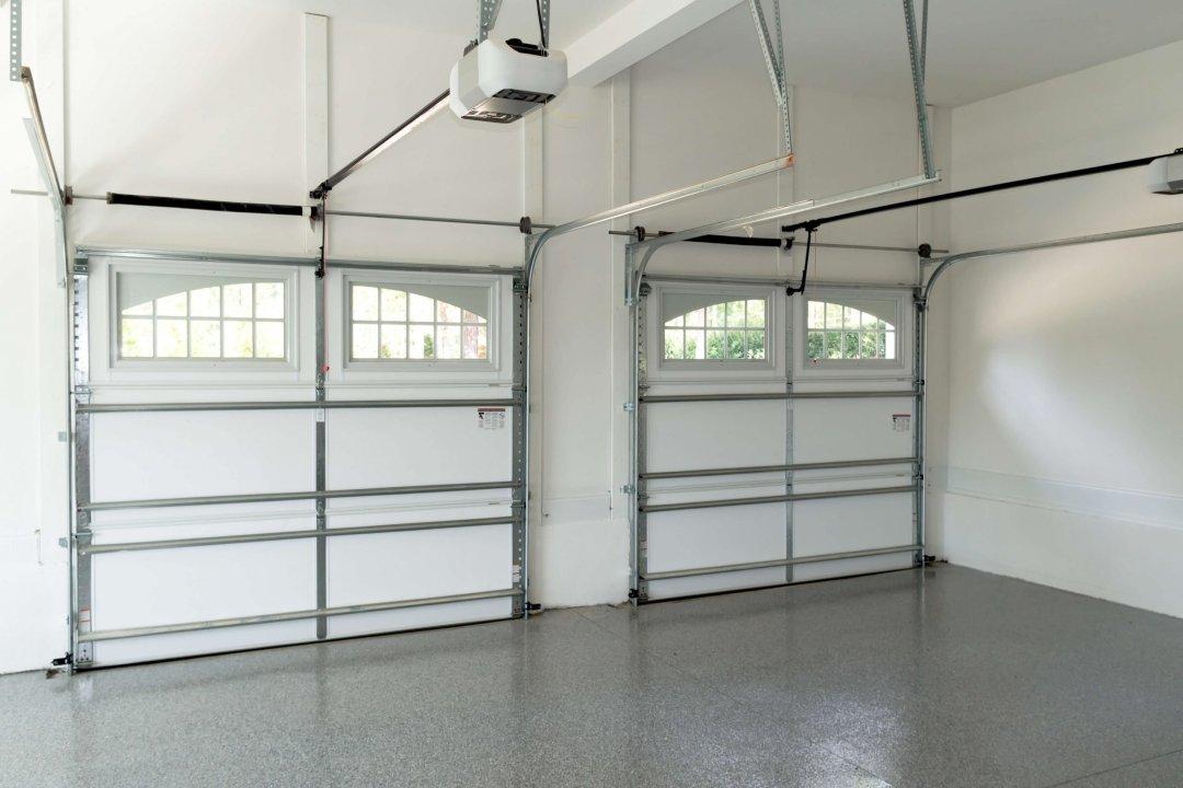 inside of a garage with a white garage door