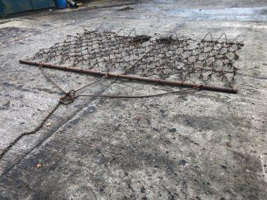 Drag chain harrows
