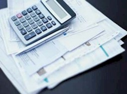 Business documents, paper and calculator on desk