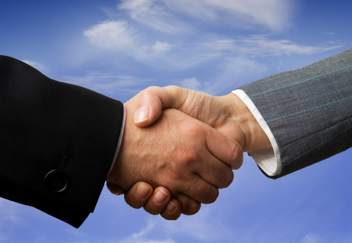 Bussiness partnership handshake