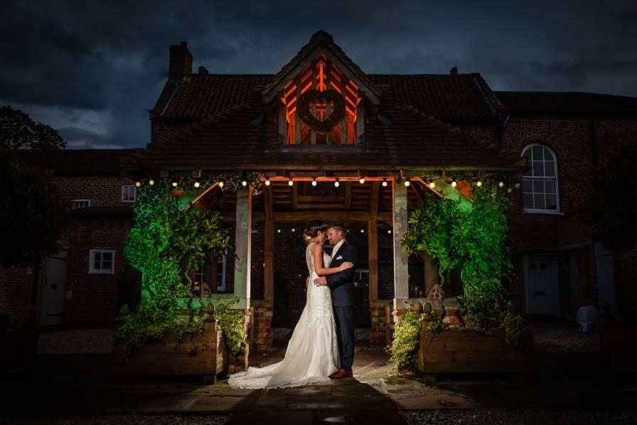Bride and groom in stunning wedding portrait at Hornington Manor