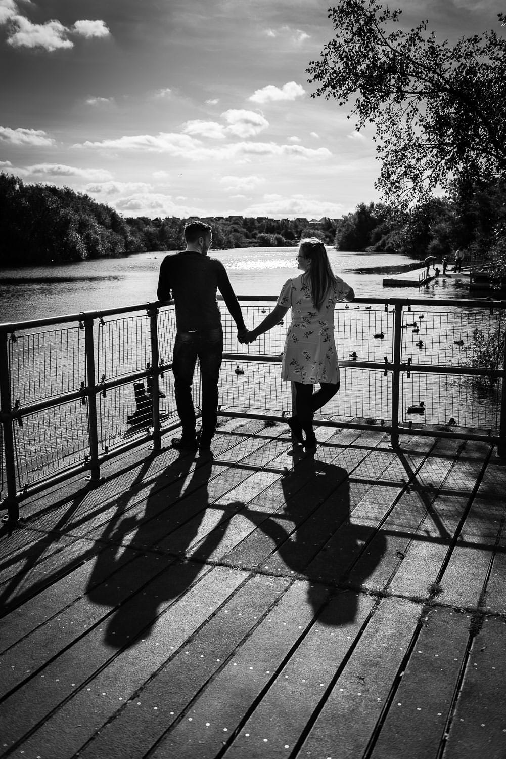 Pre wedding photoshoot, engaged, wedding day planning, couple holding hands on summers day at riverbank