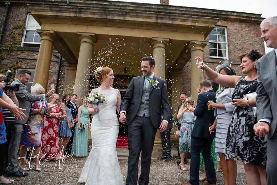 North Yorkshire wedding venue, solberge hall, confetti, bride and groom