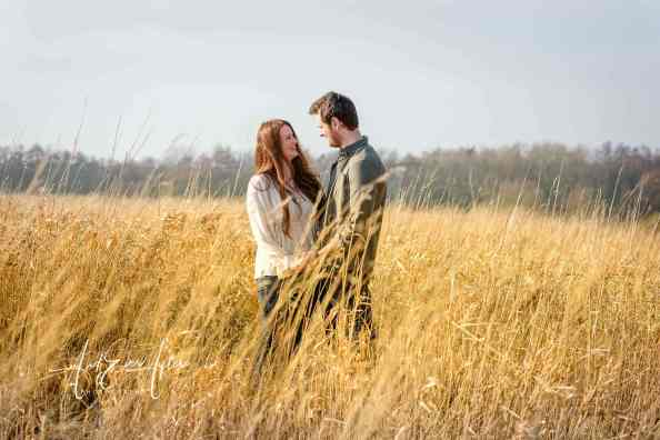 engagement photoshoot, couple in field of long grass