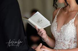 Wedding ceremony bride reading her vows