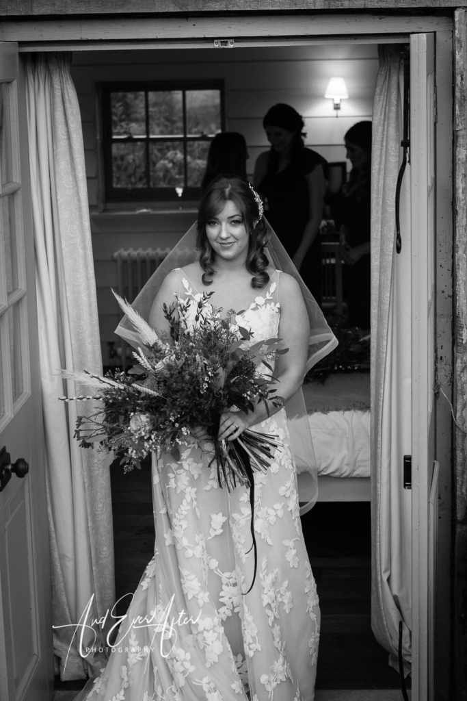 middelton lodge wedding day with bride posing with her wedding flowers