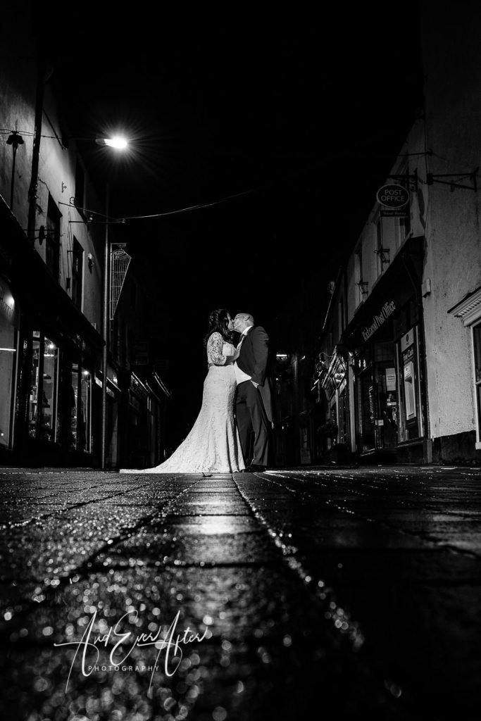 bride and goom posing in a street in richmond north yorkshire