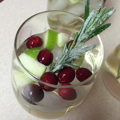 it is officially the holidays and that means white christmas sangria ive made variations of this sangria the past couple of years and everyone comments on