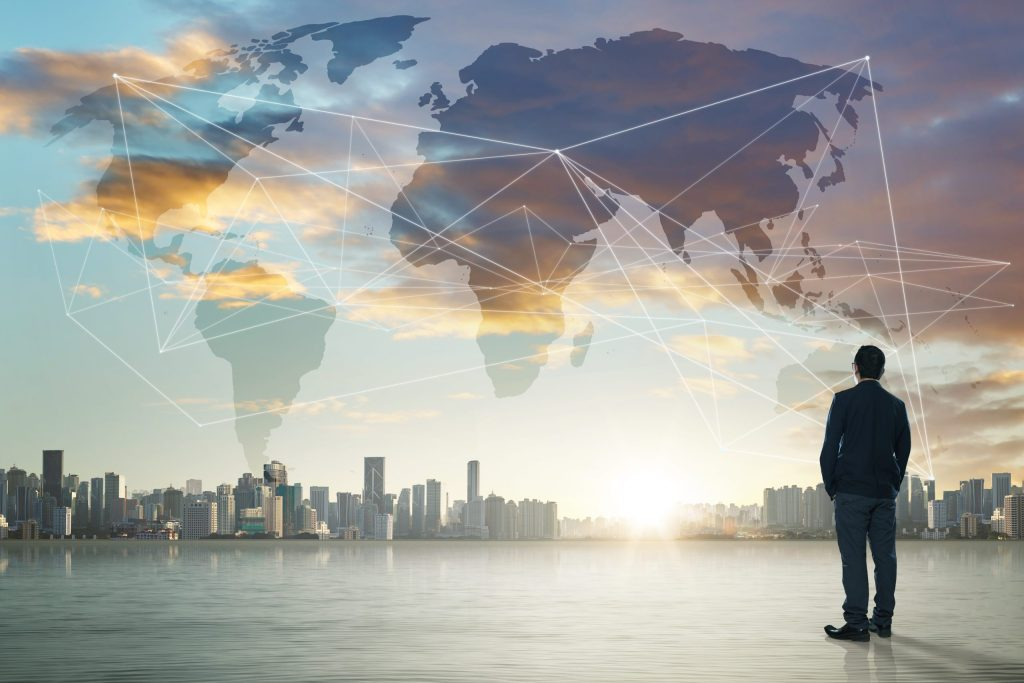 graphicstock international business concept with businessman on city skyline background with network on map and sunlight rOFam3Dxjl scaled - Ma che fine hai fatto?