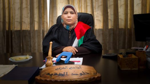 The-Judge-Kholoud at Desk