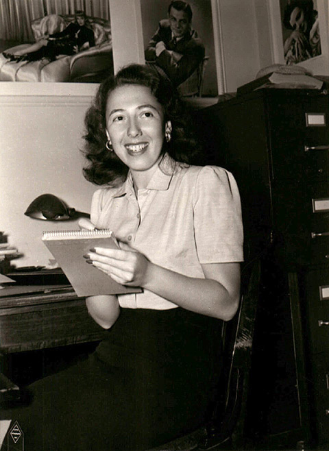 """Photo of Still Gallery department head Ethel Sackin, in charge of creating the fantasy images and glamorous """"look"""" of the Warner Bros. stars (1944)."""