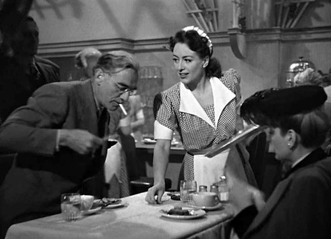 Joan Crawford as Mildred Pierce. Warner Bros., 1945.