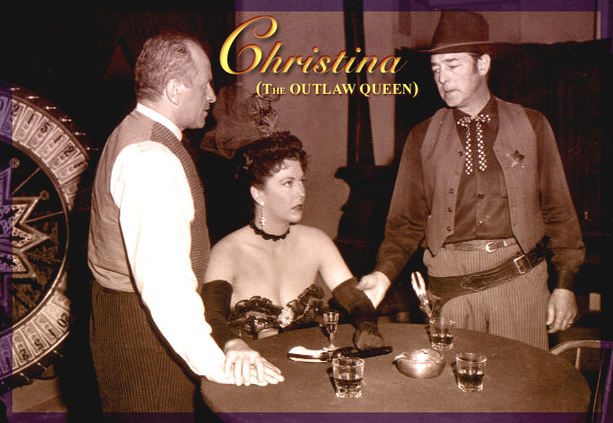 "Andrea King, starring as Christina in ""Outlaw Queen"" (Globe Releasing Corp., 1957), sits between James Harakas (left, as Uncle Jim) and Kenne Duncan (right, as the Sheriff)."
