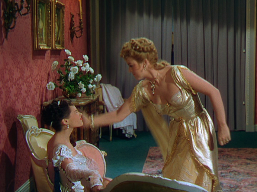 Photo of Yvonne De Carlo and Andrea King in a knock-down-drag-out!