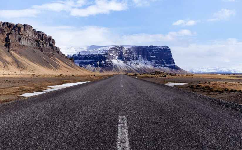 asphalt road and mountain in the background