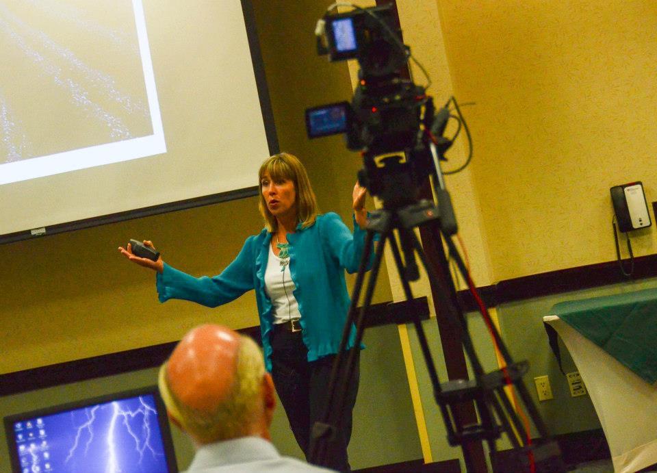 Andrea speaking in Denver