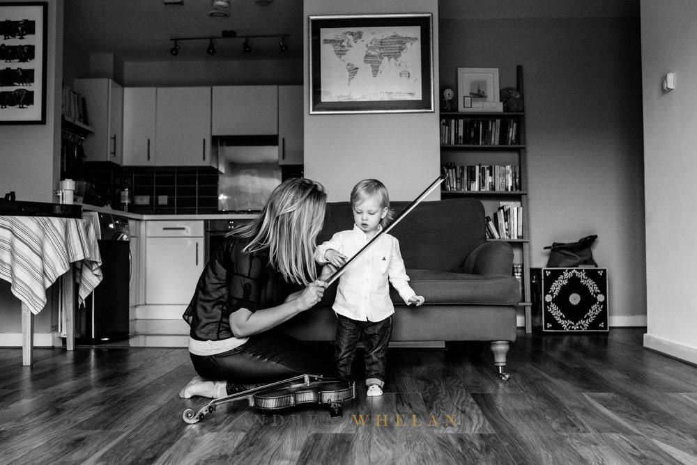 Mum and boy playing violin