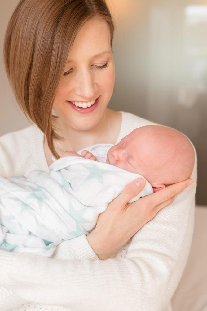 Close up new mum and tiny baby