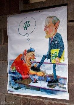 Карикатура на А. Гарсия и Дж. Буша.