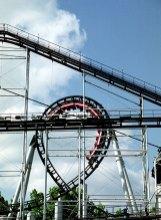 """Аттракцион """"Ninja - the black belt of roller coasters"""". Отличительная черта: множество двойных спиралей и """"мертвых петель"""". Не для слабонервных! Six Flags."""