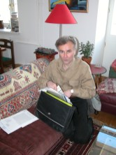 Early 2000's. Andrei at his friend's place getting ready for the next trip. It is Doug Birch's flat in Moscow.