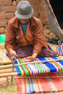 Aymara woman weaving
