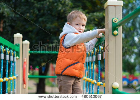 stock-photo-little-boy-walking-on-the-boards-on-the-playground-the-boy-clinging-to-the-railing-with-his-hands-480513067