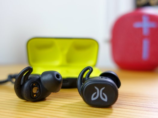 Jaybird Vista earbuds with open case in background