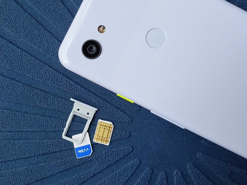 Visible SIM card next to Pixel 3a