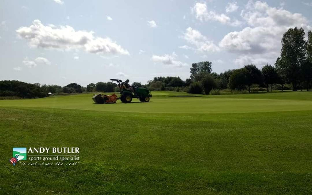 Golf green maintenance in Ferndown, Dorset, at the Dudsbury Luxury Golf Club Hotel & Spa, August 2019