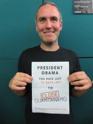 Sam Raphael of the University of Westminster reminding President Obama he had just 70 days left to close Guantanamo, on November 10, 2016 (Photo: Andy Worthington).