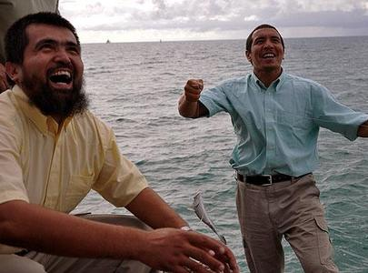 Salahidin Abdulahad and Khalil Manut, photographed by Michelle Shephard for the Toronto Star, enjoy their new-found freedom by fishing in the ocean