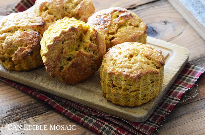 Healthy Pumpkin Scones on Bread Board on Top of Red and Green Fabric