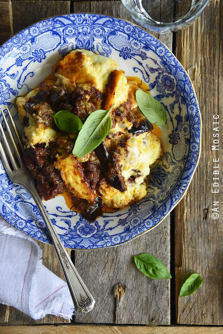 Low Carb Beef Eggplant Moussaka Casserole (Gluten Free) in Dish on Rustic Wooden Table