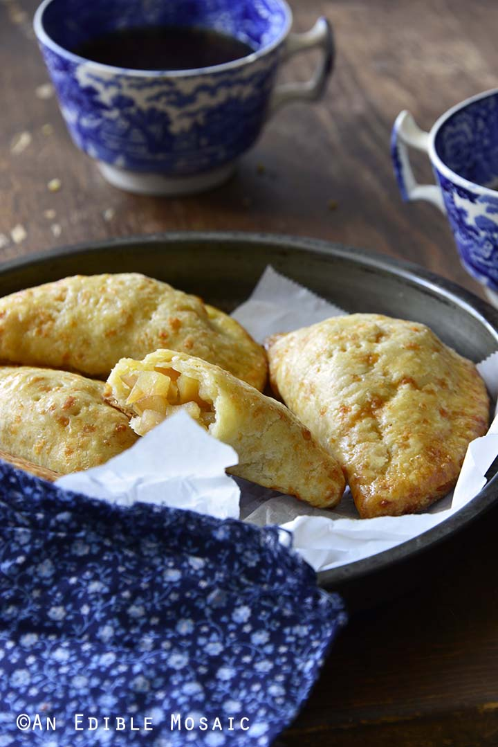 Sweet Apple Hand Pies with Cheddar Shortcrust Showing Flaky Pastry Crust Fruit Filling