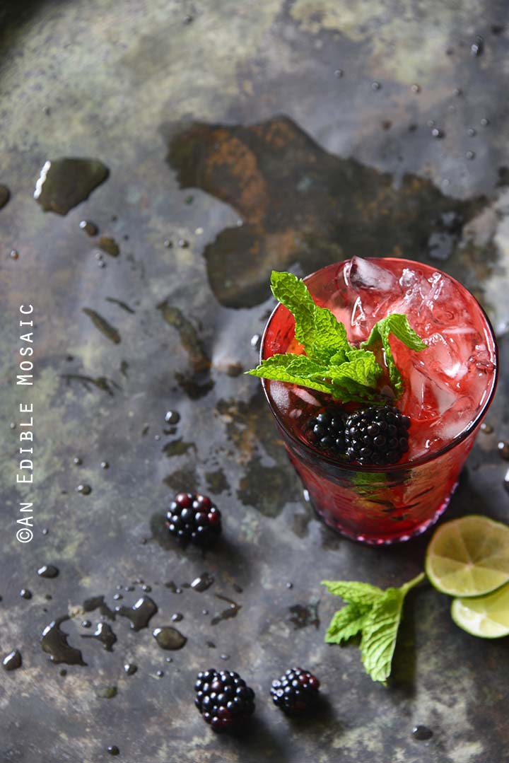 Blackberry Syrup, Mint, and Lime Spritzers on Metal Tray Top View Vertical Orientation