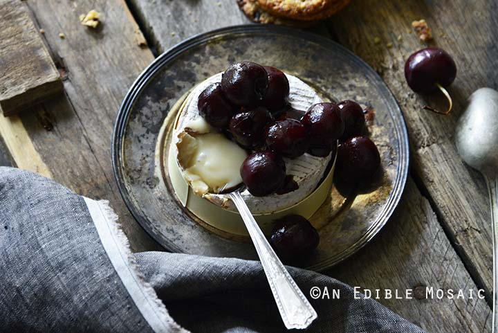 Baked Goat Brie with Balsamic-Roasted Cherries Front View Horizontal Orientation