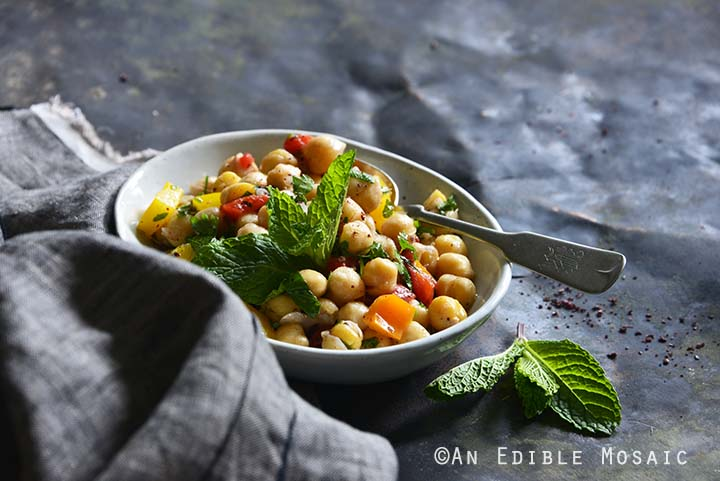 Sweet Pepper Chickpea Salad with Mint and Honey-Sumac Vinaigrette Front View Metal Background Horizontal Orientation