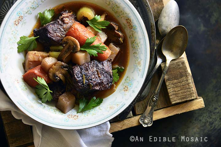 Braised Beef with Root Vegetables and Red Wine on Wooden Table Top View Horizontal Orientation