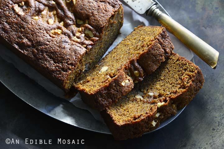 Slices of Chai-Spiced Brown Butter Pumpkin Walnut Loaf Cake