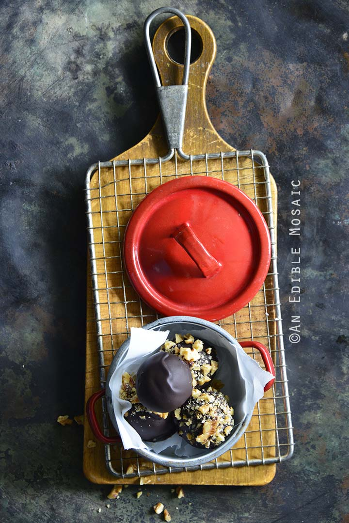 Keto Chocolate-Coated Maple Walnut Cheesecake Truffles Top View Metal Background