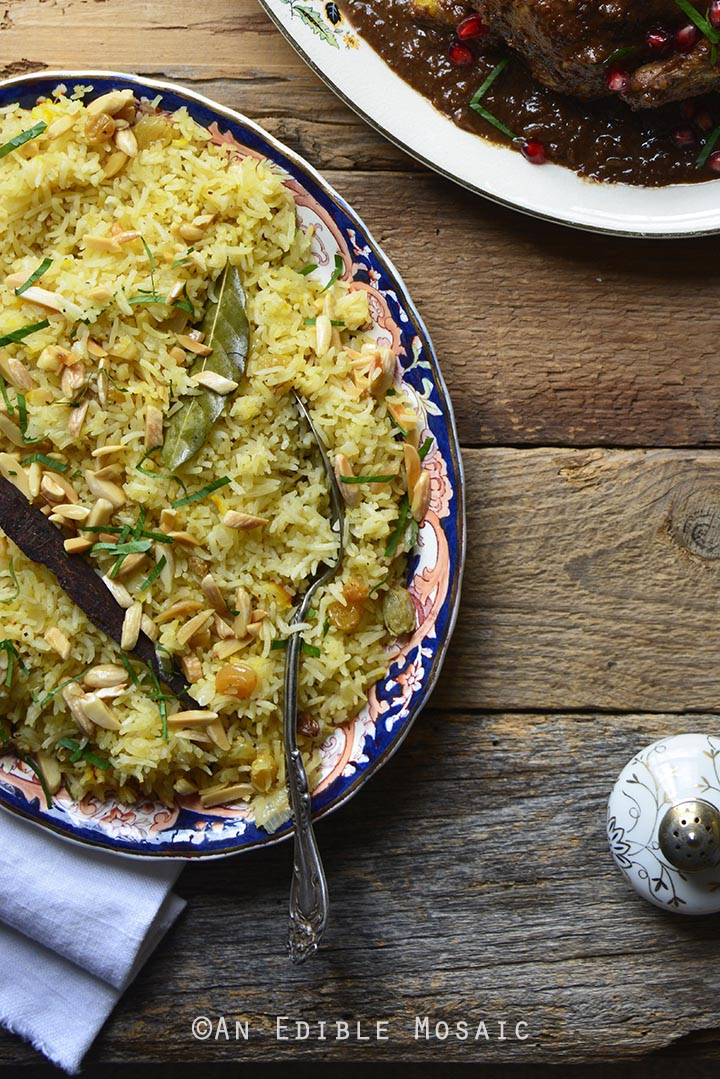 Orange and Toasted Almond Saffron Rice Pilaf with Golden Raisins on Wooden Table