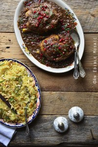 Persian Inspired Cornish Hens with Pomegranate Walnut Sauce with Golden Pilaf on Wooden Table